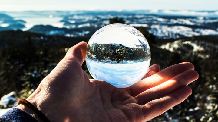 hand holding crystal ball.