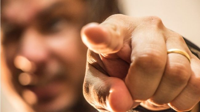 close up of finger pointing at you.