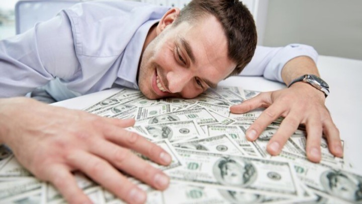 Man hugging money.