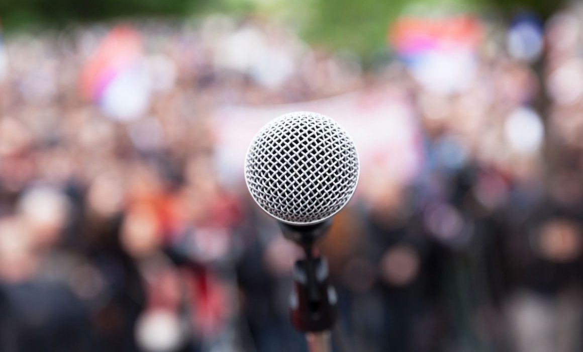 close up of microphone in front of a crowd