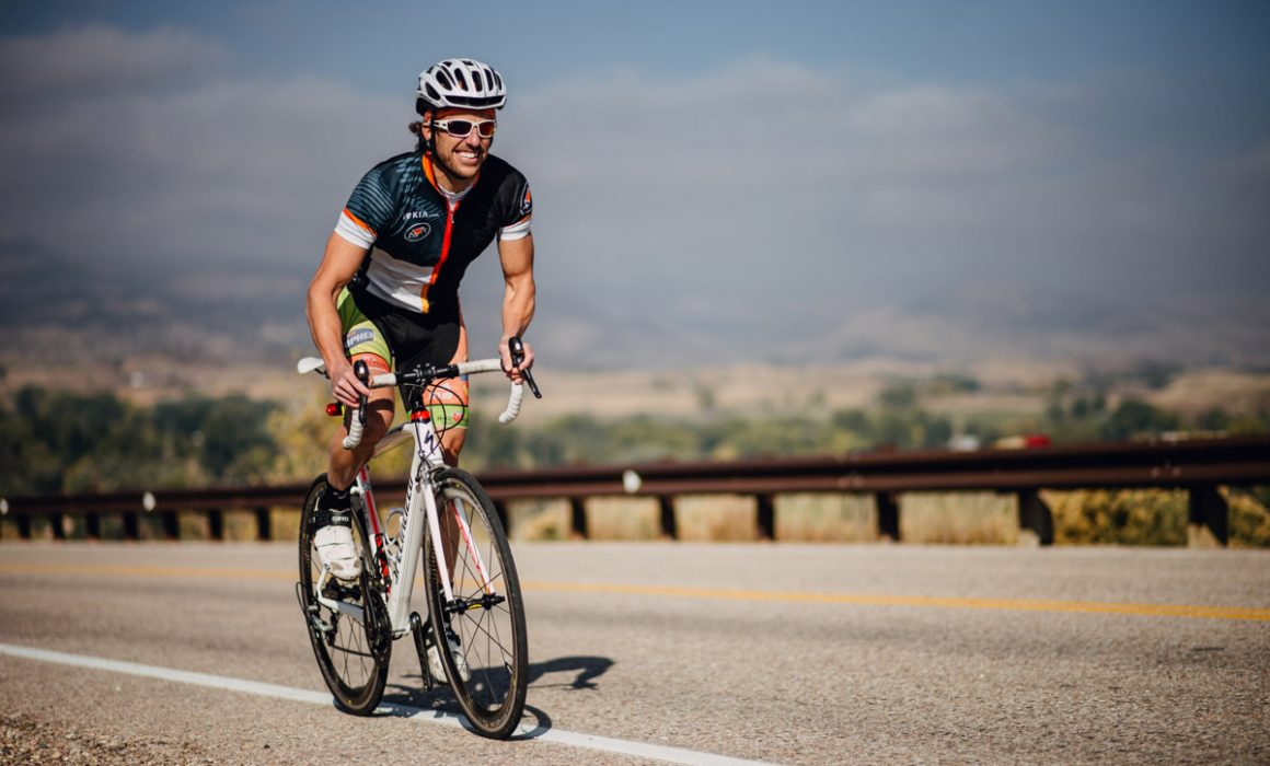 Andy riding a bike during an Ironman competition.